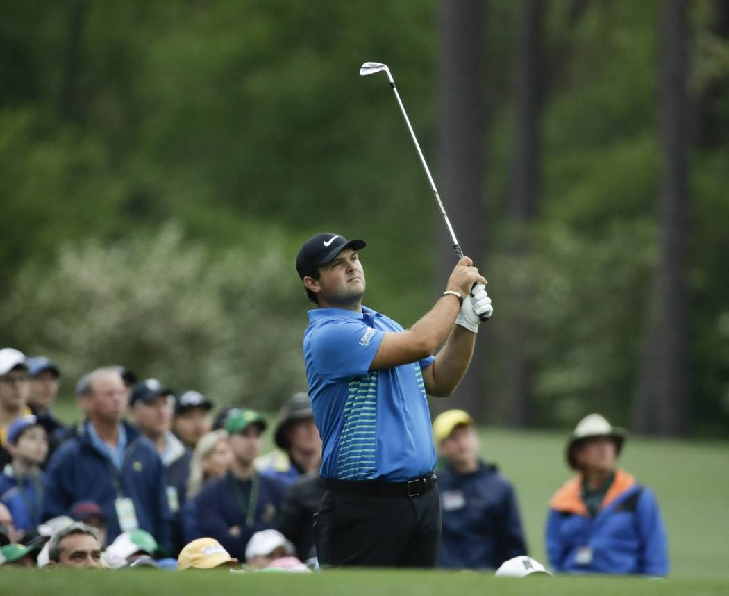 Patrick Reed watches his shot on the 12th hole during the third round at the Masters golf tournament Saturday, April 7, 2018, in Augusta, Ga. (AP Photo/Chris Carlson)