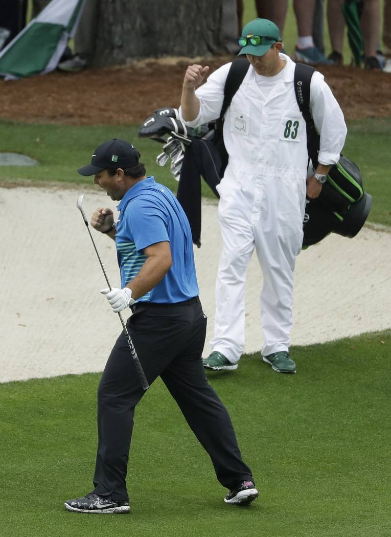 Patrick Reed reacts after his eagles on the 15th hole during the third round at the Masters golf tournament Saturday, April 7, 2018, in Augusta, Ga. (AP Photo/Matt Slocum)