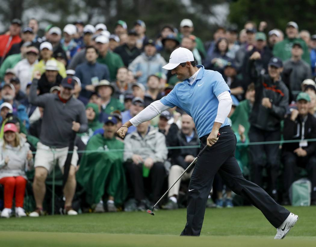 Rory McIlroy, of Northern Ireland, reacts after making a birdie putt on the 18th hole during the third round at the Masters golf tournament Saturday, April 7, 2018, in Augusta, Ga. (AP Photo/Matt  ...