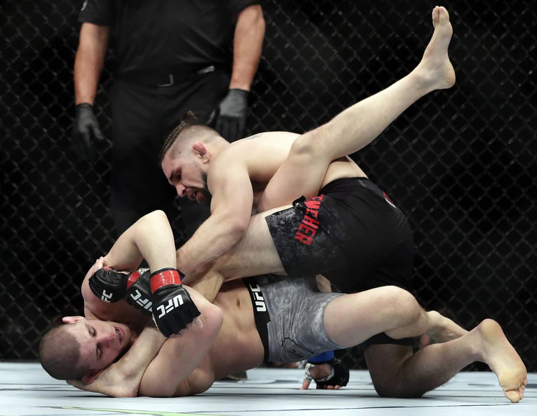Chris Gruetzemacher, above, fights Chris Gruetzemacher during the first round of a lightweight mixed martial arts bout at UFC 223, Saturday, April 7, 2018, in New York.  Gruetzemacher stopped Lauz ...