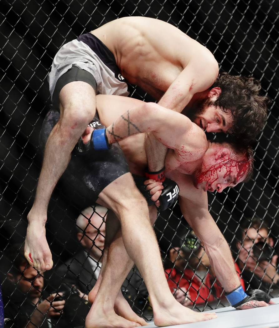 Russia's Zabit Magomedsharipov, top, grapples with Kyle Bochniak during the third round of a featherweight mixed martial arts bout at UFC 223, Saturday, April 7, 2018, in New York. Magomedsharipov ...