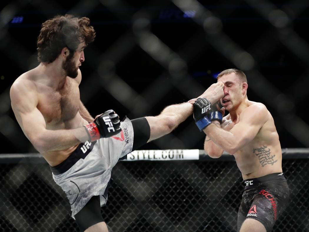 Russia's Zabit Magomedsharipov, left, kicks Kyle Bochniak during the second round of a featherweight mixed martial arts bout at UFC 223, Saturday, April 7, 2018, in New York. Magomedsharipov won t ...