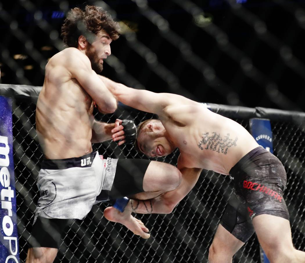Russia's Zabit Magomedsharipov, left, fights Kyle Bochniak, right, during the first round of a featherweight mixed martial arts bout at UFC 223, Saturday, April 7, 2018, in New York. Magomedsharip ...