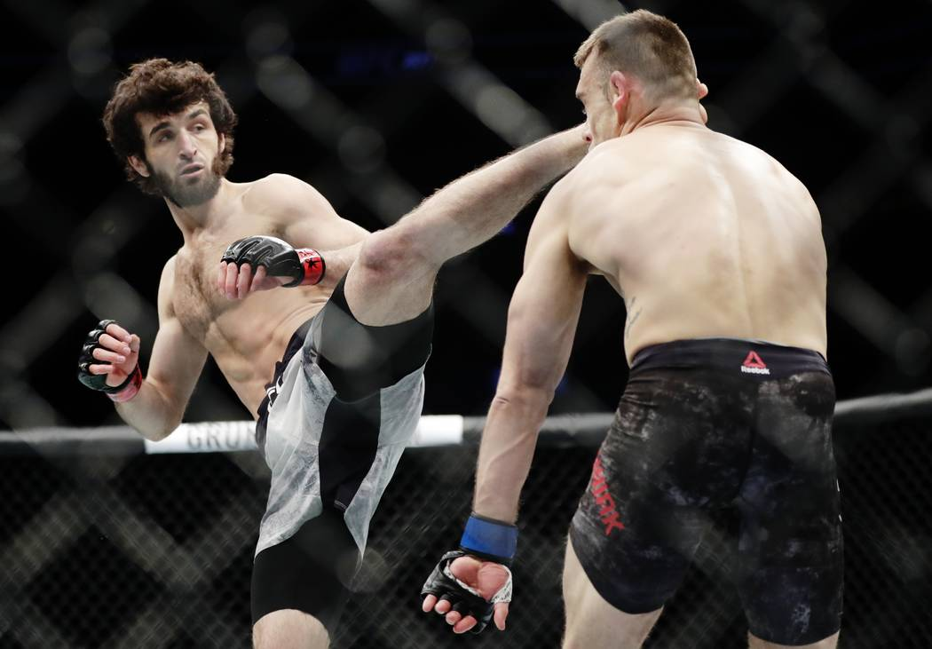 Russia's Zabit Magomedsharipov, left, kicks Kyle Bochniak during the first round of a featherweight mixed martial arts bout at UFC 223, Saturday, April 7, 2018, in New York. Magomedsharipov won th ...