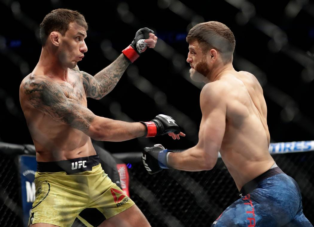 Brazil's Renato Moicano, left, and Calvin Kattar fight during the first round of a featherweight mixed martial arts bout at UFC 223 on Saturday, April 7, 2018, in New York. Moicano won the fight.  ...