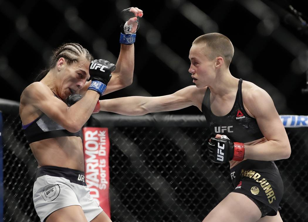 Rose Namajunas, right, punches Poland's Joanna Jedrzejczyk during the first round of a women's strawweight title bout at UFC 223 early Sunday, April 8, 2018, in New York. Namajunas won the fight.  ...