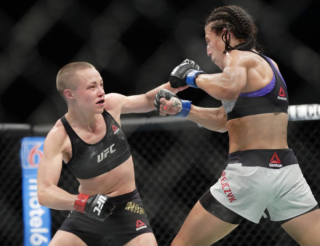 Rose Namajunas, left, punches Poland's Joanna Jedrzejczyk during the fifth round of a women's strawweight title bout at UFC 223 early Sunday, April 8, 2018, in New York. Namajunas won the bout. (A ...