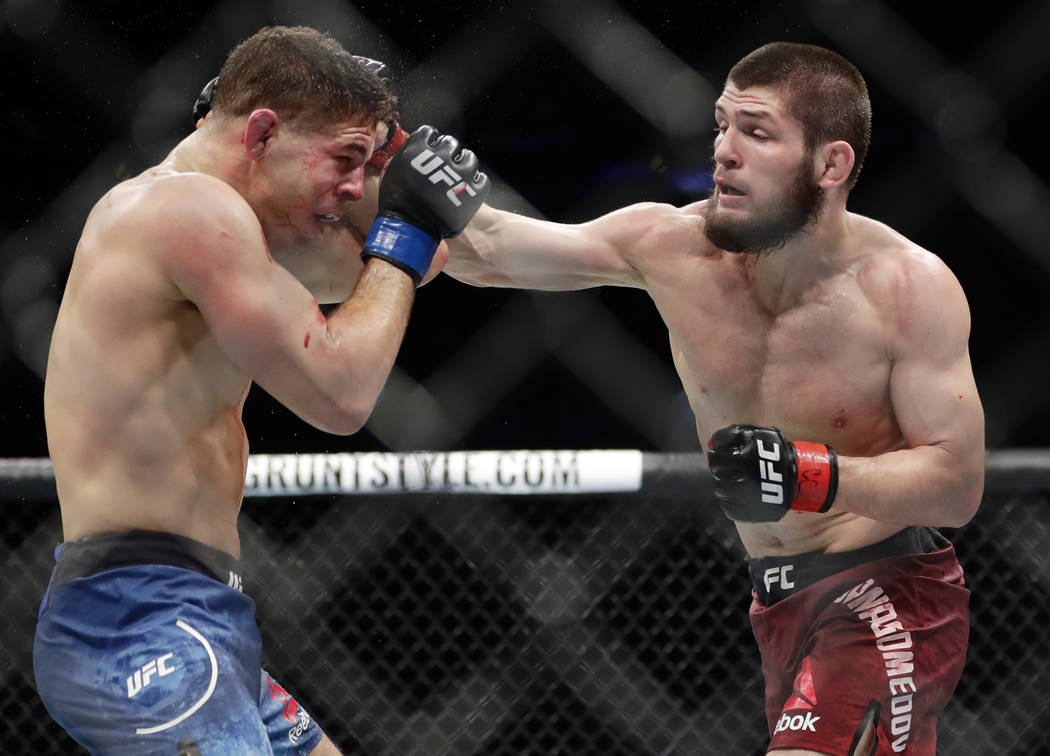 Russia's Khabib Nurmagomedov, right, punches Al Iaquinta during the fourth round of a lightweight title bout at UFC 223 early Sunday, April 8, 2018, in New York. Nurmagomedov won the fight. (AP Ph ...
