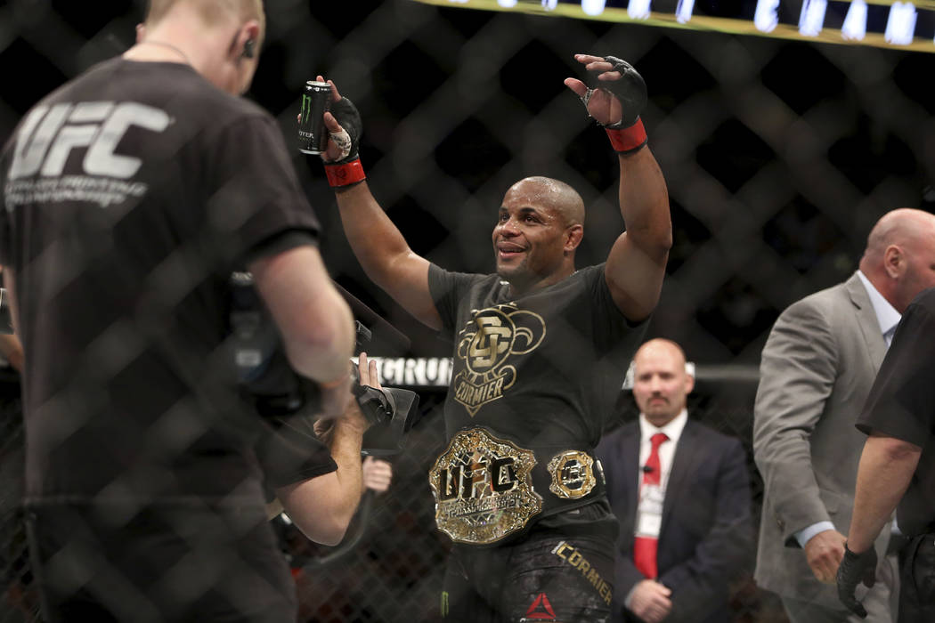 Daniel Cormier wears the belt after a win over Volkan Oezdemir in a light heavyweight championship mixed martial arts bout at UFC 220, Saturday, Jan. 20, 2018, in Boston.  (AP Photo/Gregory Payan)