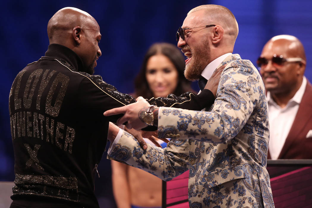 Floyd Mayweather, left, and Conor McGregor joke around at the post fight press conference on Saturday, Aug 26, 2017, at T-Mobile Arena, in Las Vegas. (Benjamin Hager/Las Vegas Review-Journal) @ben ...