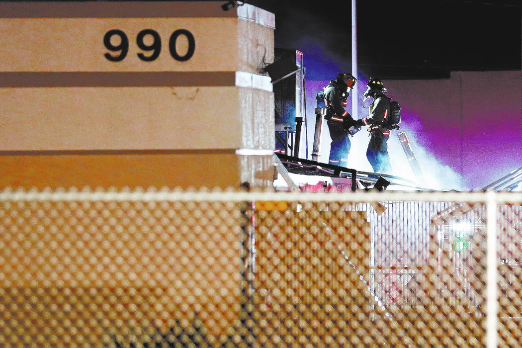 Firefighters work to extinguish a fire on West Washington Street in Las Vegas, Saturday, April 7, 2018. Chitose Suzuki Las Vegas Review-Journal @chitosephoto