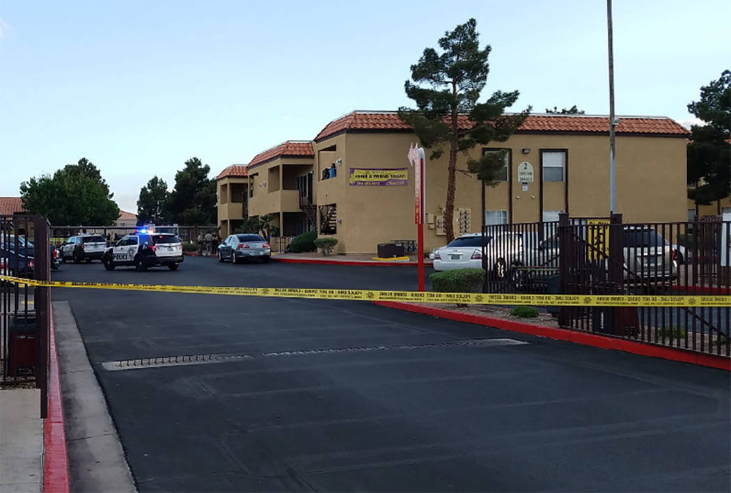 Police investigate a homicide at 2895 E. Charleston Blvd., near Fremont Street, in Las Vegas on Saturday, April 7, 2018. (Mike Shoro/Las Vegas Review-Journal)