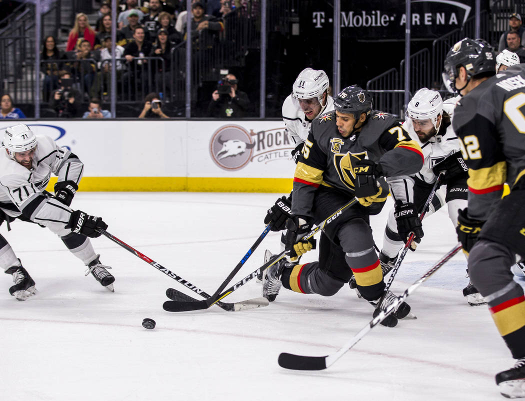 Vegas Golden Knights right wing Ryan Reaves (75) tries to take the puck away from Los Angeles Kings center Torrey Mitchell (71), Los Angeles Kings center Anze Kopitar (11) and Los Angeles Kings de ...