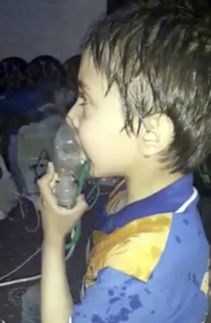 This image made from video released by the Syrian Civil Defense White Helmets, which has been authenticated based on its contents and other AP reporting, shows a toddler given oxygen through respi ...