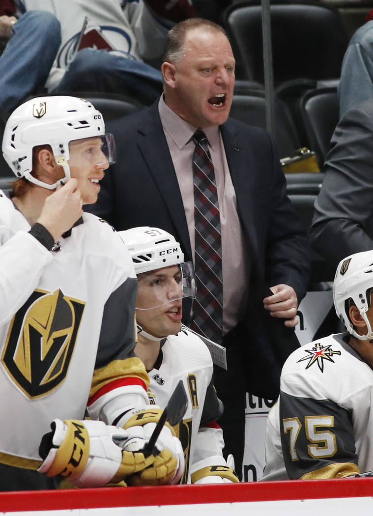 Vegas Golden Knights head coach Gerard Gallant directs his team against the Colorado Avalanche in the second period of an NHL hockey game Saturday, March 24, 2018, in Denver. (AP Photo/David Zalub ...