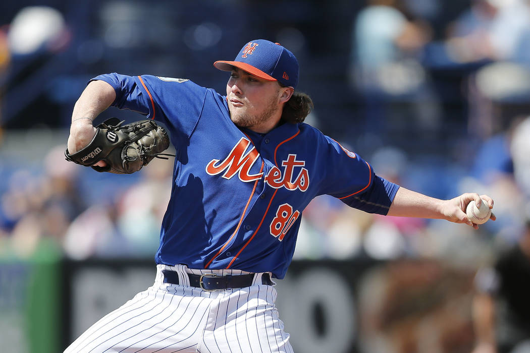 New York Mets starting pitcher P.J. Conlon (80) works against the Houston Astros in the first inning of a spring training baseball game Monday, Feb. 27, 2017, in Port St. Lucie, Fla. He had a stro ...
