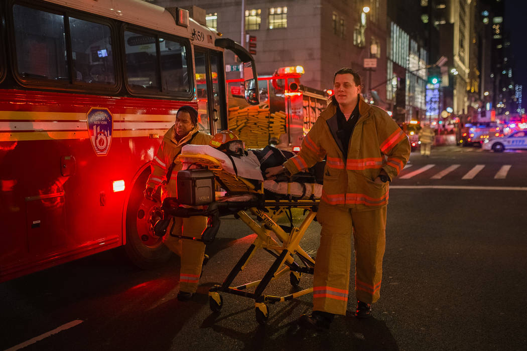 Emergency personnel leave the scene after a fire in Trump Tower, Saturday, April 7, 2018, in New York. The fire department says a blaze broke out on the 50th floor shortly before 6 p.m. Saturday.  ...