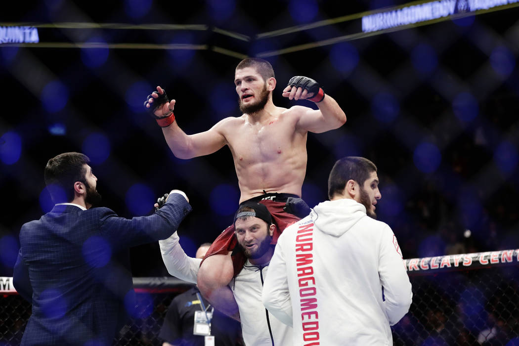 Russia's Khabib Nurmagomedov celebrates after a lightweight title bout against Al Iaquinta at UFC 223 early Sunday, April 8, 2018, in New York. Nurmagomedov won the fight. (AP Photo/Frank Franklin II)