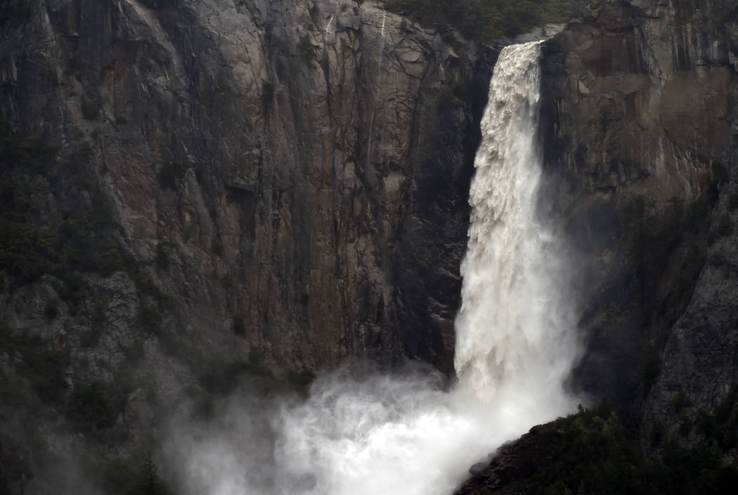 A raging Bridalveil Fall plummets into Yosemite Valley, closed to the public due to a flooding Merced River, in Yosemite National Park on Saturday, April 7, 2018. (Eric Paul Zamora/The Fresno Bee  ...