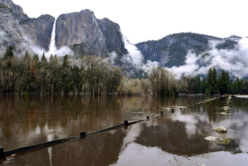 Cook's Meadow is flooded by the rising Merced River in Yosemite National Park's Yosemite Valley on Saturday, April 7, 2018. (Eric Paul Zamora/The Fresno Bee via AP)