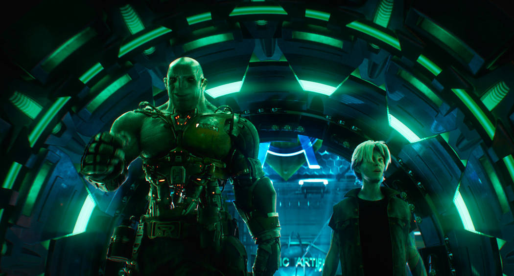 """Aech, left, and Parzival in a scene from """"Ready Player One,"""" a film by Steven Spielberg. (Warner Bros. Pictures via AP)"""