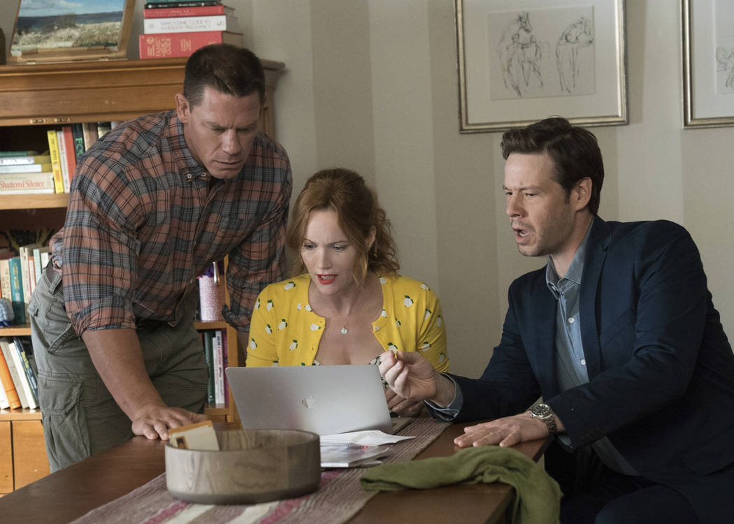 """John Cena, from left, Leslie Mann and Ike Barinholtz in a scene from """"Blockers."""" (Quantrell D. Colbert/Universal Pictures via AP)"""