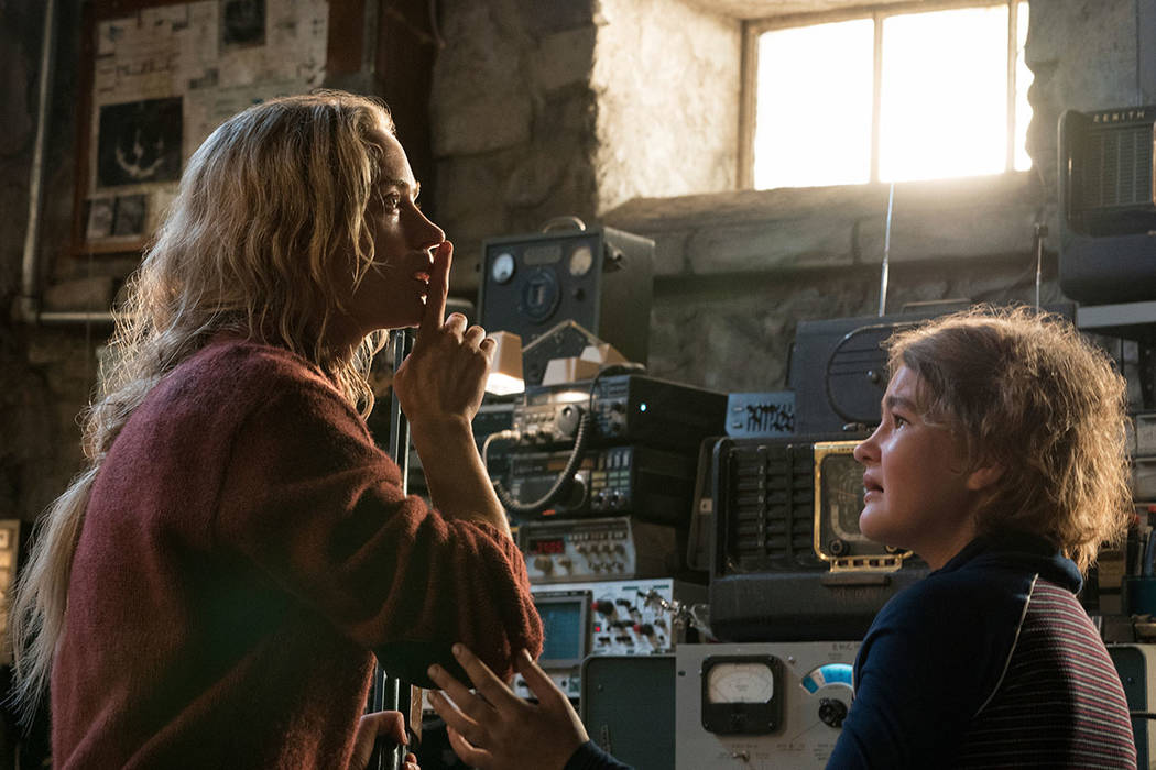 """Emily Blunt, left, and Millicent Simmonds in a scene from """"A Quiet Place."""" (Jonny Cournoyer/Paramount Pictures via AP)"""