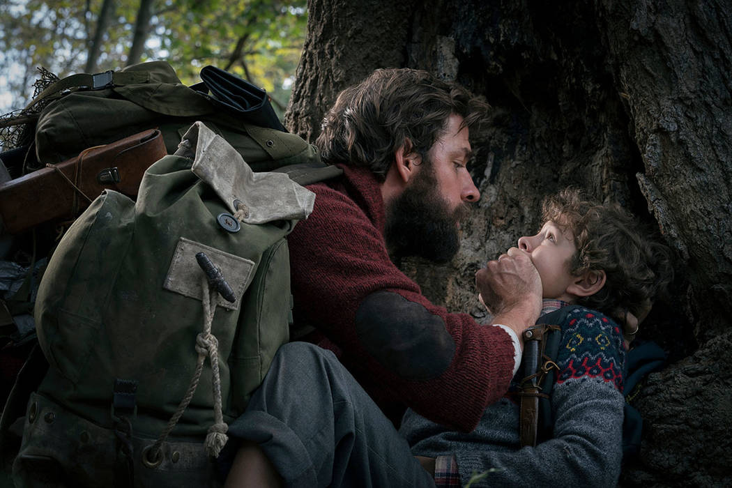 """John Krasinski, left, and Noah Jupe in a scene from """"A Quiet Place."""" (Jonny Cournoyer/Paramount Pictures via AP)"""