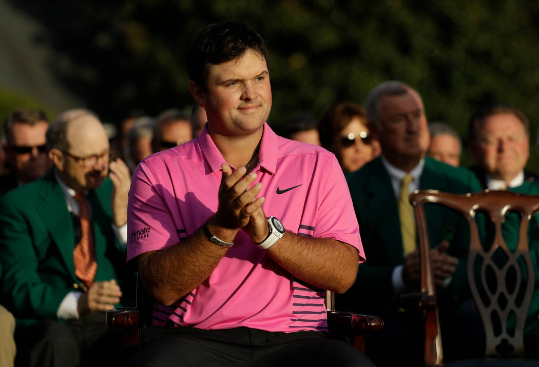 Patrick Reed's applauds during presentations after his win at the Masters golf tournament Sunday, April 8, 2018, in Augusta, Ga. (AP Photo/Matt Slocum)