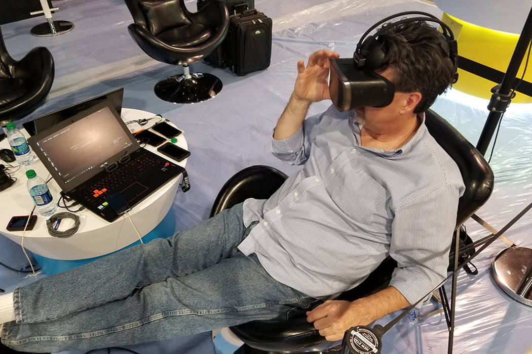 Jeff Miller, U.S. sales director for Israeli graphic arts company HumanEyes, adds video to a virtual reality headset at the Las Vegas Convention Center on Sunday, April 8, 2018. Miller will showca ...