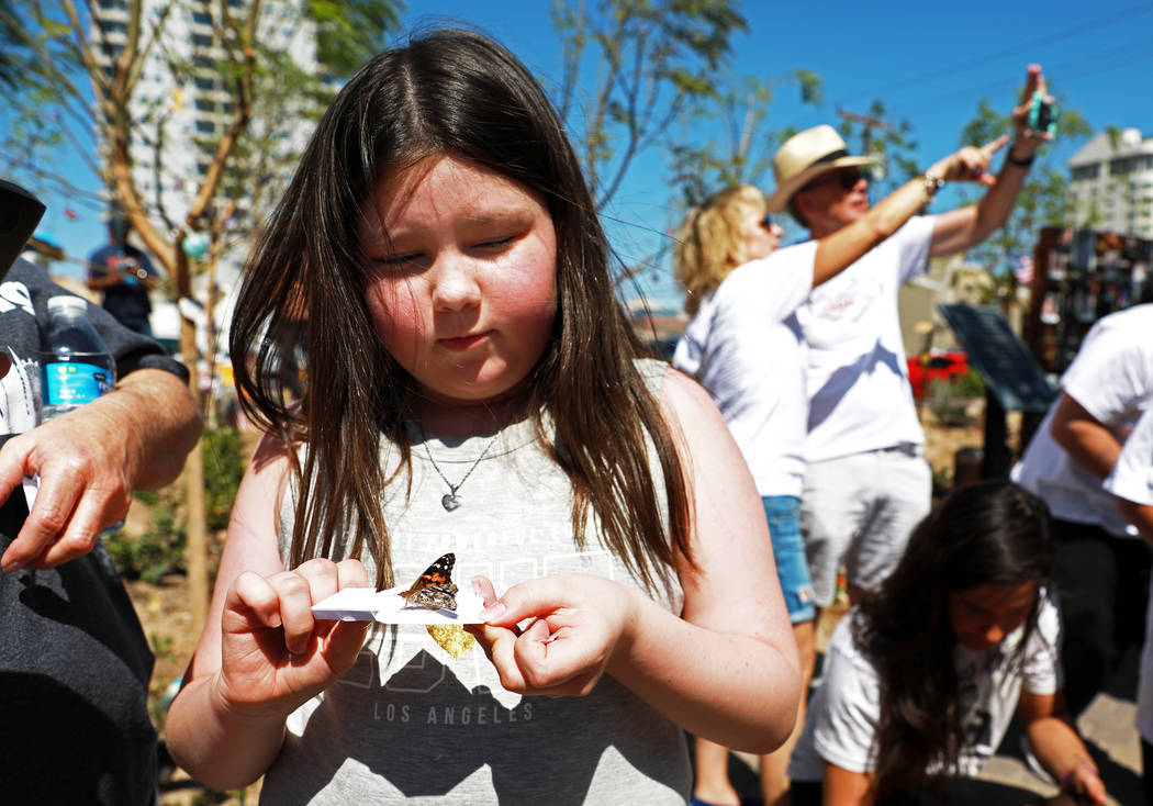 Navaeh Dennis, 9, releases a butterfly during a commemorative butterfly release ceremony for those lost or affected by the Oct.1 shooting at the Healing Garden in Las Vegas on Sunday, April 8, 201 ...