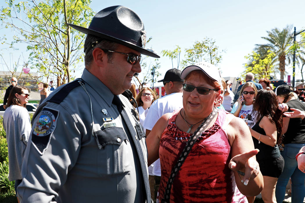 Nevada Highway Patrol Trooper Travis Smaka and Leala Tyree meet for the first time since the Oct.1 shooting during a commemorative butterfly release ceremony at the Healing Garden in Las Vegas on  ...