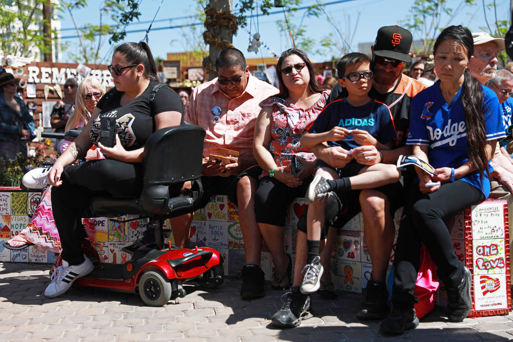 Attendees gather for a commemorative butterfly release ceremony for those lost or affected by the Oct.1 shooting at the Healing Garden in Las Vegas on Sunday, April 8, 2018. Andrea Cornejo Las Veg ...