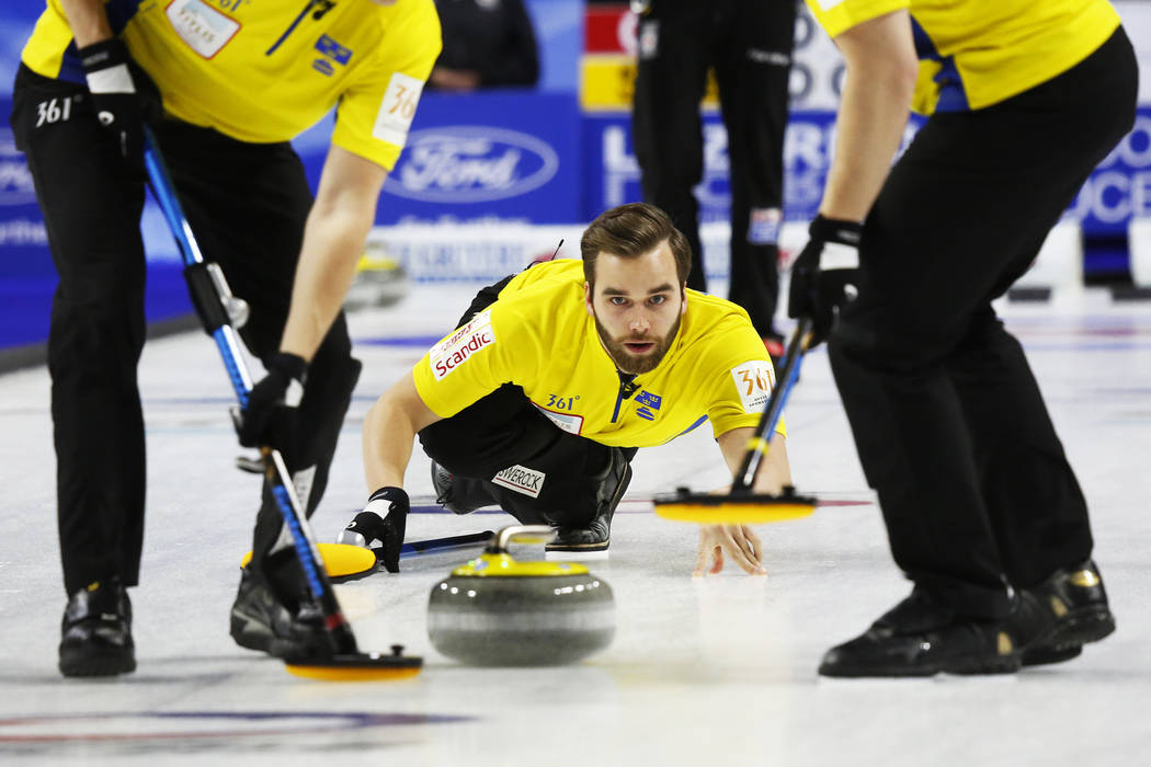 Team Sweden's Oskar Eriksson delivers the rock to sweepers during the World Men's Curling Championship against Canada at the Orleans Arena in Las Vegas on Sunday, April 8, 2018. Andrea Cornejo Las ...
