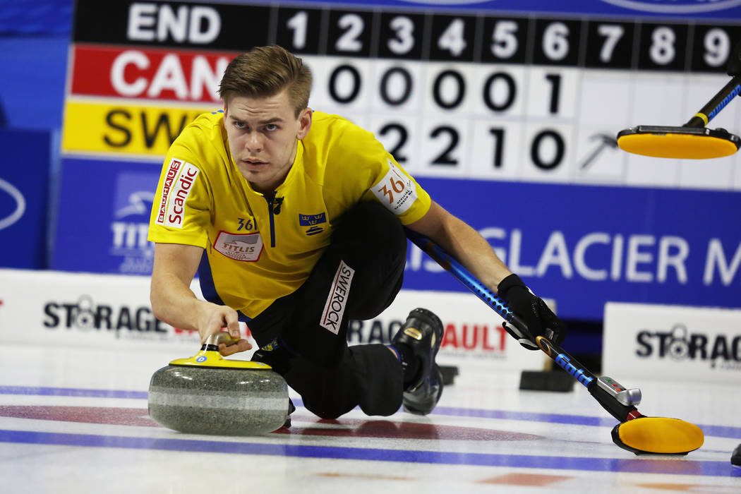 Team Sweden's Christoffer Sundgren delivers the rock to sweepers during the World Men's Curling Championship against Canada at the Orleans Arena in Las Vegas on Sunday, April 8, 2018. Andrea Corne ...