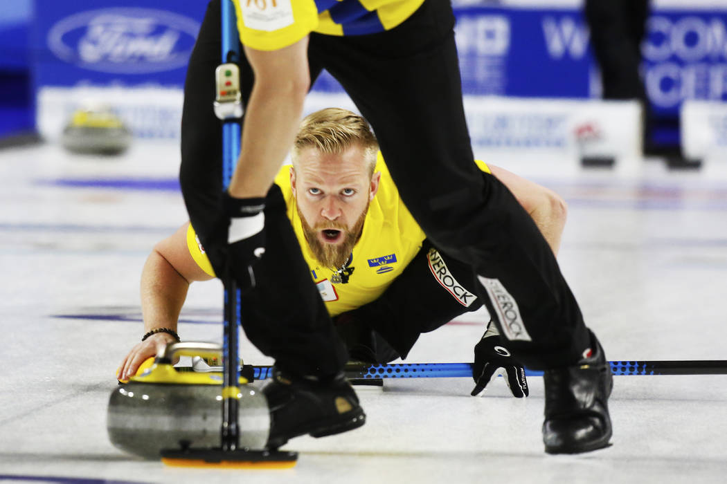 Team Sweden Niklas Edin delivers the rock to sweepers in the World Men's Curling Championship against Canada at the Orleans Arena in Las Vegas on Sunday, April 8, 2018. Andrea Cornejo Las Vegas Re ...