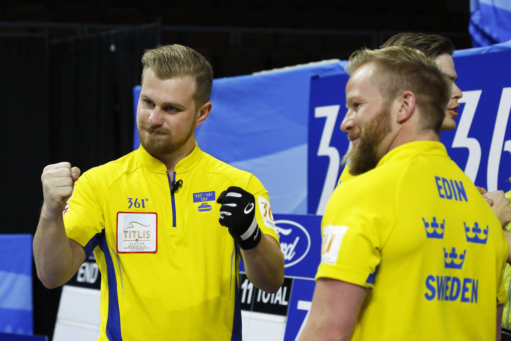 Team Sweden's Rasmus Wranaa, left, and Niklas Edin celebrate after defeating Canada in the World Men's Curling Championship at the Orleans Arena in Las Vegas on Sunday, April 8, 2018. Andrea Corne ...