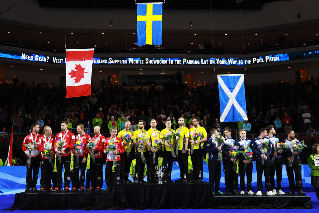 Team Sweden, center, receive their trophy after defeating Canada in the World Men's Curling Championship at the Orleans Arena in Las Vegas on Sunday, April 8, 2018. Andrea Cornejo Las Vegas Review ...