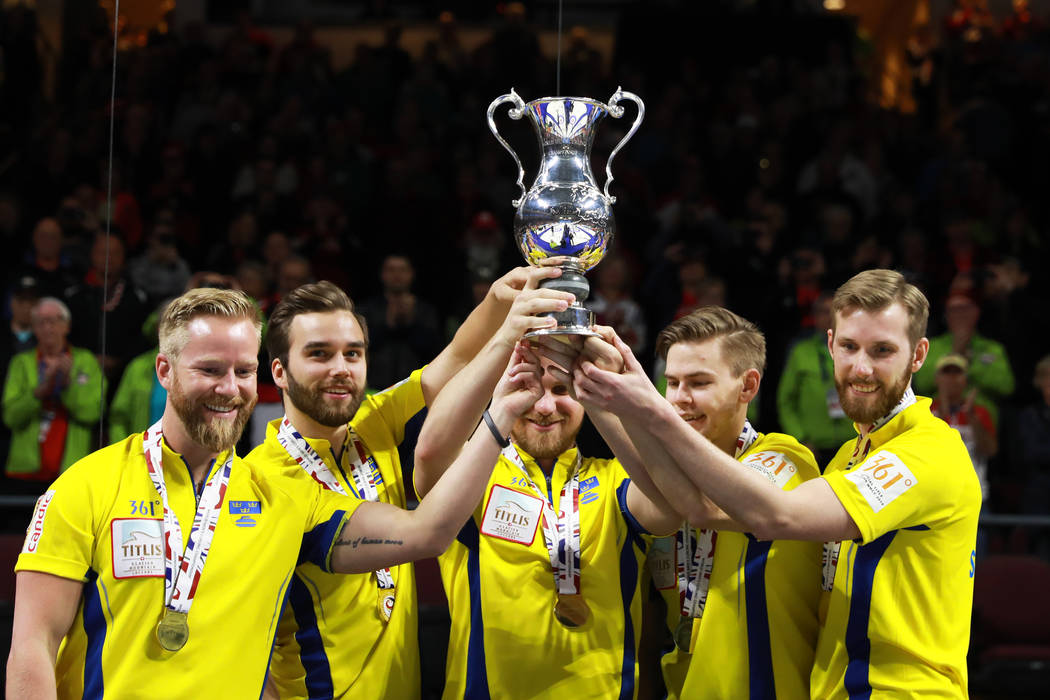 Team Sweden hoists their trophy after defeating Canada in the World Men's Curling Championship at the Orleans Arena in Las Vegas on Sunday, April 8, 2018. Andrea Cornejo Las Vegas Review-Journal @ ...