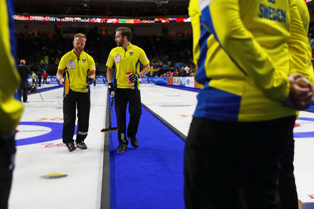 Team Sweden's Niklas Edin, left, and Oskar Eriksson talk amongst themselves during the World Men's Curling Championship against Canada at the Orleans Arena in Las Vegas on Sunday, April 8, 2018. A ...