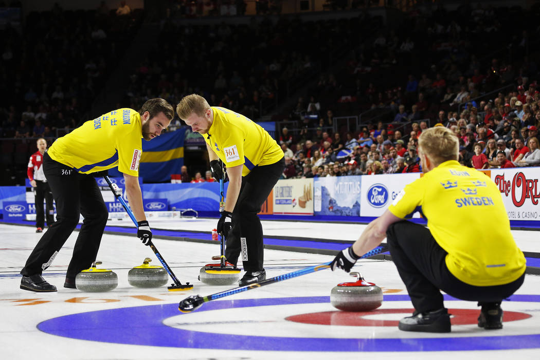 Team Sweden's Oskar Eriksson and Rasmus Wranaa sweep against Canada during the World Men's Curling Championship at the Orleans Arena in Las Vegas on Sunday, April 8, 2018. Andrea Cornejo Las Vegas ...