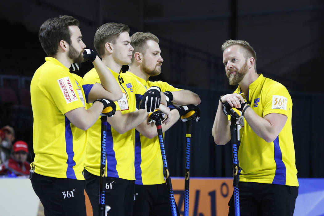 From left, Sweden's Oskar Eriksson, Christoffer Sundgren, Rasmus Wranaa and Niklas Edin talk amongst themselves during the World Men's Curling Championship against Canada at the Orleans Arena in L ...