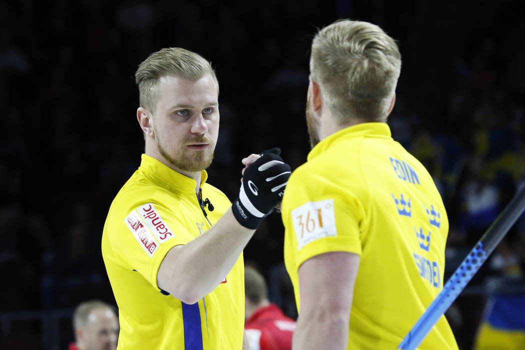 Team Sweden's Rasmus Wranaa celebrates with Niklas Edin after delivering a stone against Canada during the World Men's Curling Championship at the Orleans Arena in Las Vegas on Sunday, April 8, 20 ...