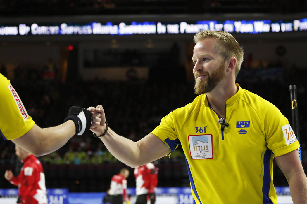 Team Sweden's Niklas Edin celebrates after delivering a stone against Canada during the World Men's Curling Championship at the Orleans Arena in Las Vegas on Sunday, April 8, 2018. Andrea Cornejo  ...
