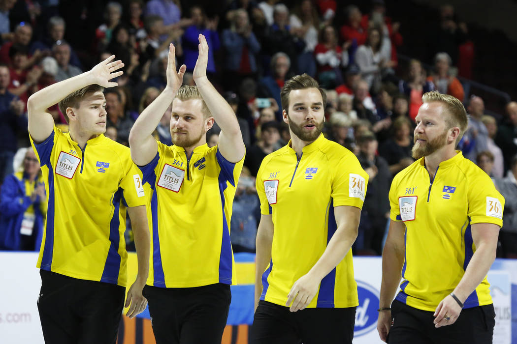 Sweden's Christoffer Sundgren, from left, Rasmus Wranaa, Oskar Eriksson and Niklas Edin celebrate after defeating Canada during the World Men's Curling Championship at the Orleans Arena in Las Veg ...