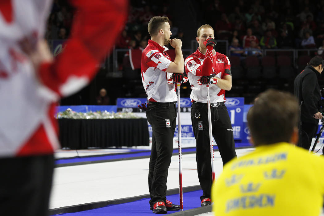 Canada's Brett Gallant, left, Geoff Walker react between ends against Sweden during the World Men's Curling Championship against Canada at the Orleans Arena in Las Vegas on Sunday, April 8, 2018.  ...