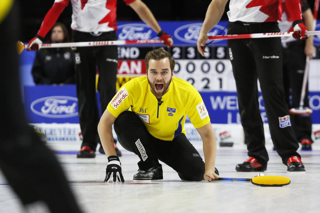 Sweden's Oskar Eriksson calls to sweepers against Canada during the World Men's Curling Championship at the Orleans Arena in Las Vegas on Sunday, April 8, 2018. Andrea Cornejo Las Vegas Review-Jou ...