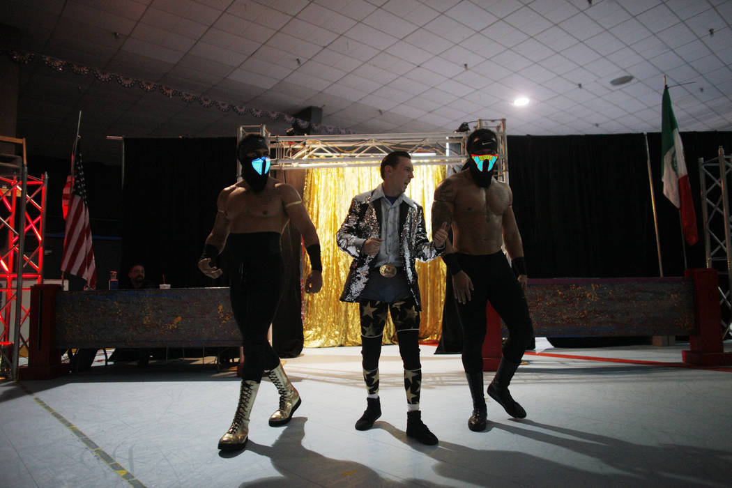 Aries Monz, from left, manager Beautiful Bobby Beamer, and Adonis Monz enter the arena for a Lucha Libre show at the Sahara Event Center in Las Vegas, Sunday, April 8, 2018. Rachel Aston Las Vegas ...