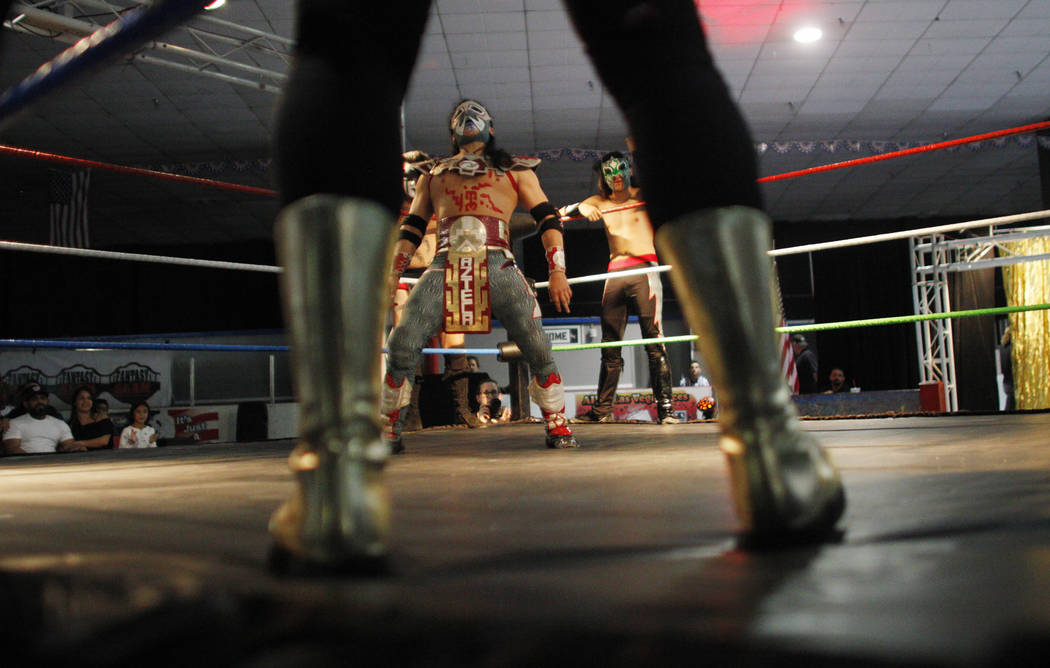 Diablo Azteca, center, faces his opponent the tag team Olympus Monz at a Lucha Libre show at the Sahara Event Center in Las Vegas, Sunday, April 8, 2018. Rachel Aston Las Vegas Review-Journal @roo ...