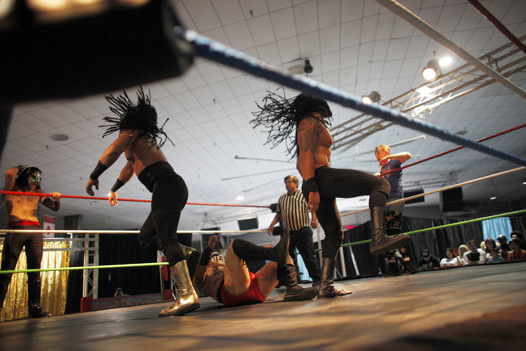 The Olympus Monz tag team slams down Wild Horse at a Lucha Libre show at the Sahara Event Center in Las Vegas, Sunday, April 8, 2018. Rachel Aston Las Vegas Review-Journal @rookie__rae